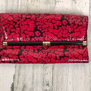 DVF Cherry red & black patterned leather clutch